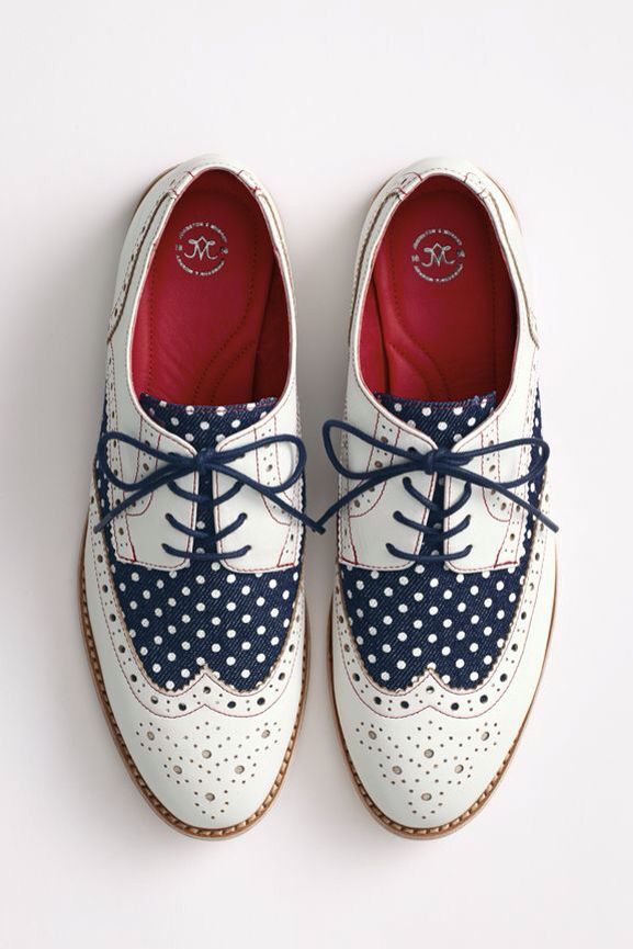 Blue and white wing tip shoes