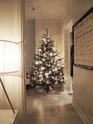 Christmas tree decorated with silver and white