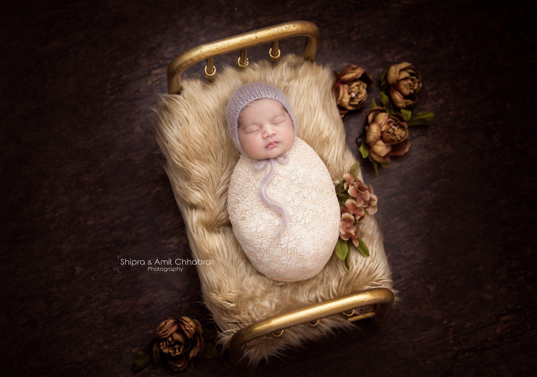 Photo shoot baby girl photoshoot newborn wraps newborn hats vintage look golden bed prop beige fur shipra amit chhabra photography