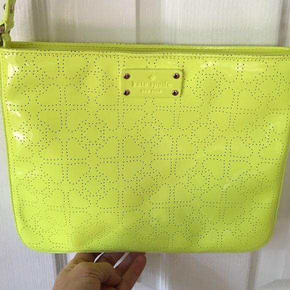 Kate Spade Handbag Neon yellow patent leather shoulder bag.  The exterior has cut out hearts. Side compartment on the inside. The interior is lined and says Kate Spade New York throughout in beige. Cross body friendly also. Authentic and perfect condition. kate spade Bags Crossbody Bags