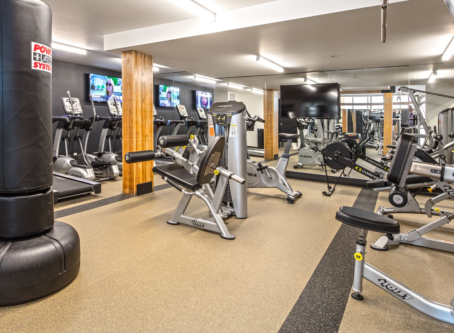 The fitness center has ellipticals, spinning bikes, and