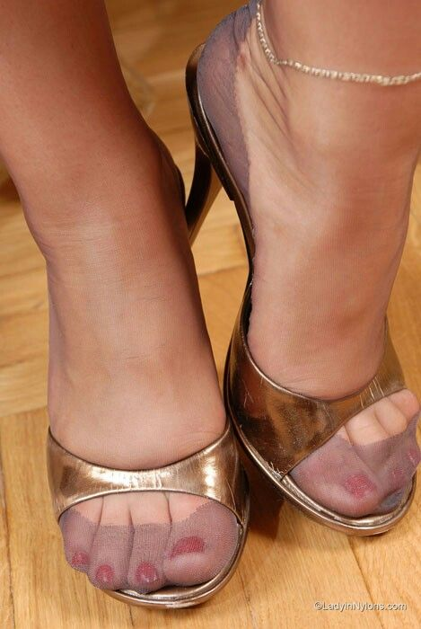 7f8d8299919 Love the RHT nylons with dark reinforcements in gold mules.