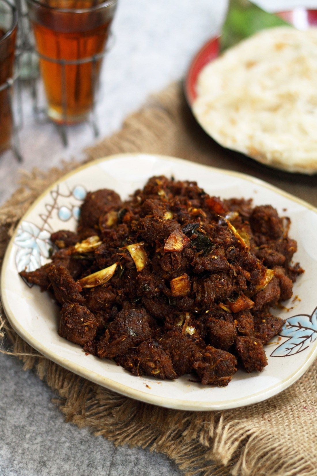 Beef Ularthiyathu Or Kerala Beef Fry Beef Cooked In A Spicy Pepper Based Masala Then Seasoned With Coconut Flakes And Cu Indian Food Recipes Beef Beef Recipes