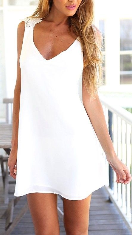 In love with this white lace criss cross back mini dress//