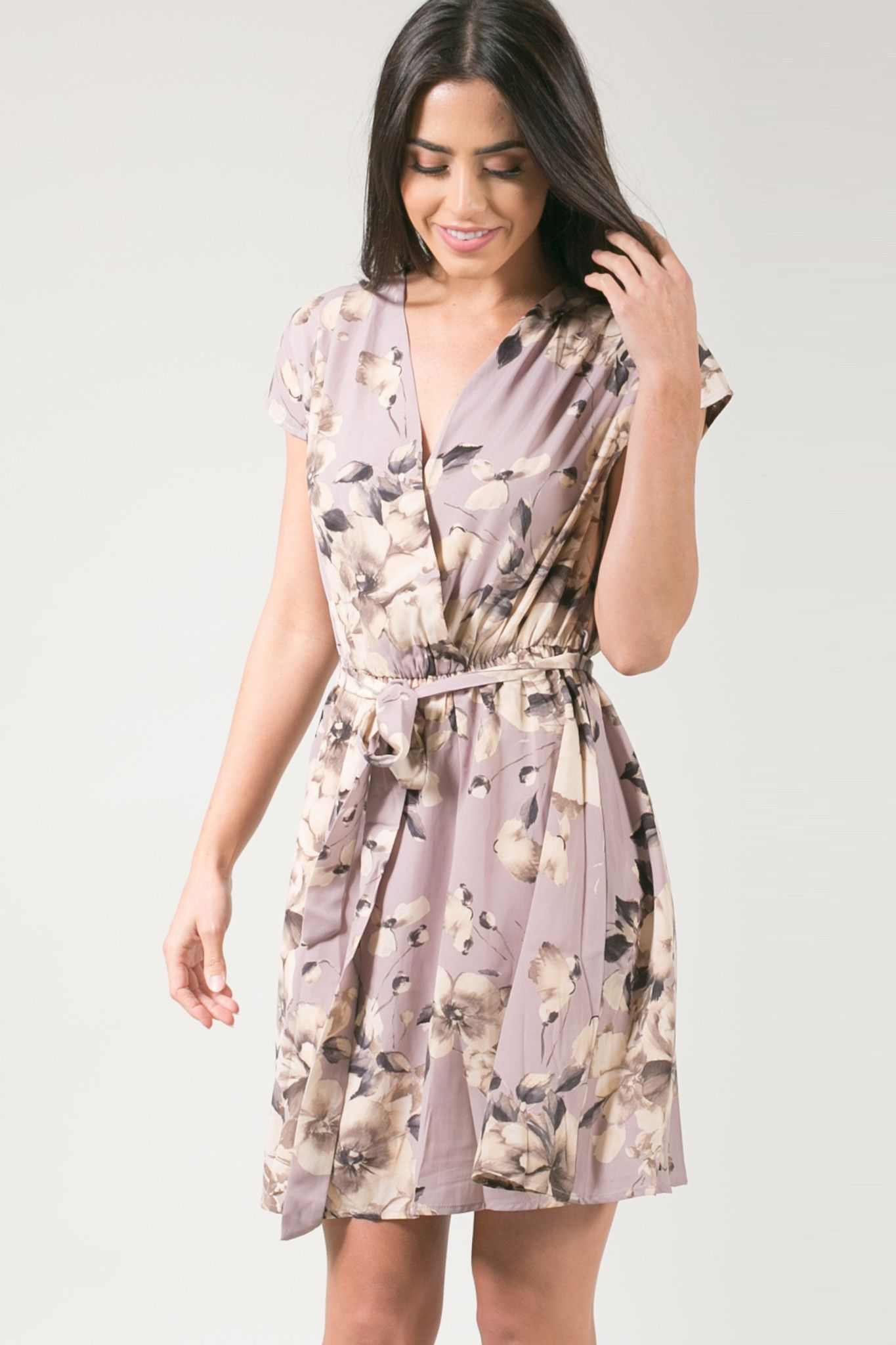 Our Olivia floral wrap dress is a must-have for looking effortlessly chic. This gorgeous mauve and taupe floral dress has an elastic waist and faux wrap style that we love so much! We are packing this