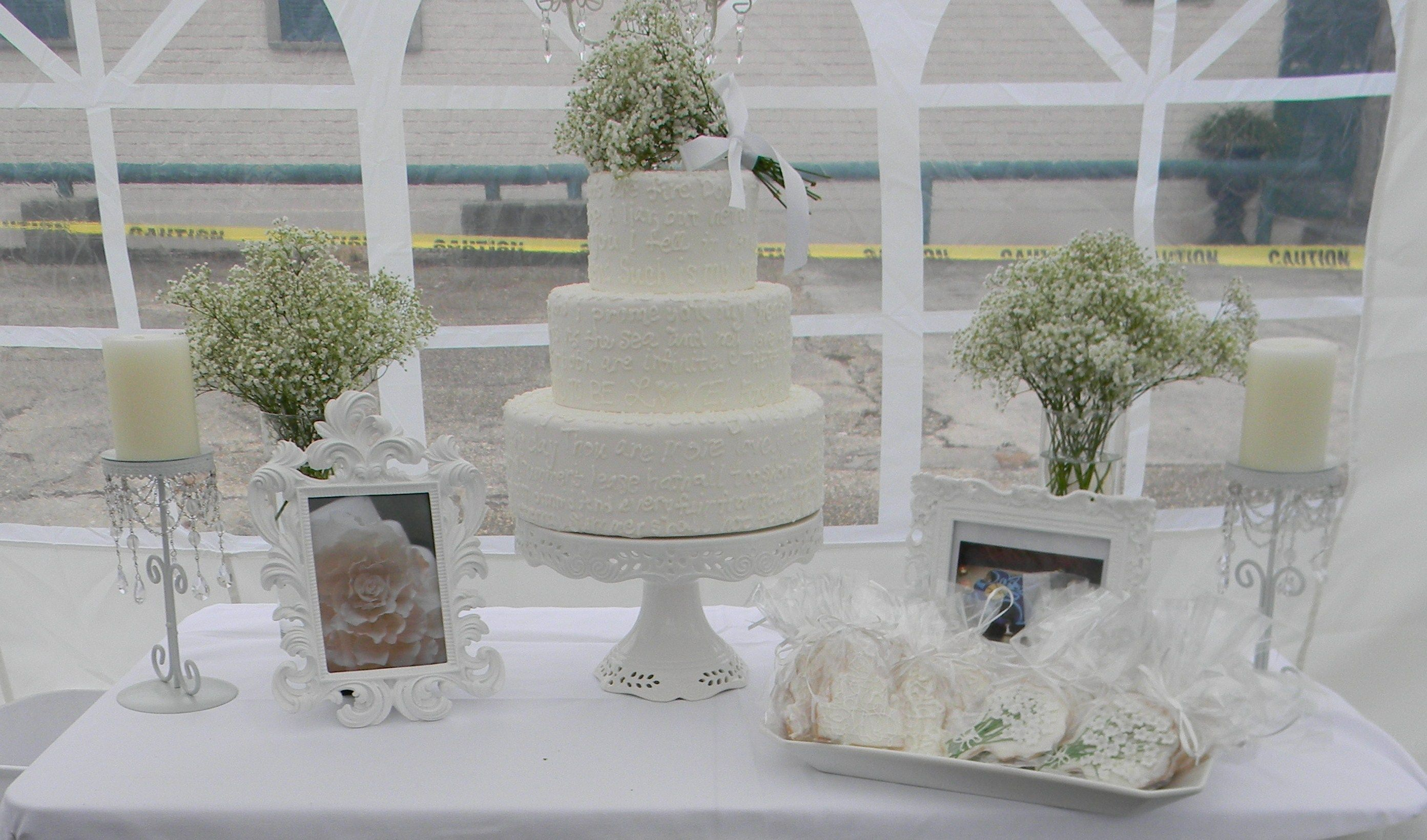 58762e1647 white wedding cake set up with baby s breath
