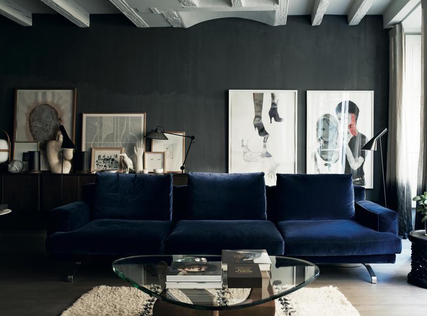 Blue sofa and Grey Walls
