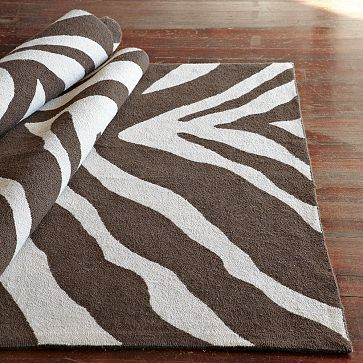I finally have my all white room...wondering if i should treat the floor with this or go for Rachel Color! Zebra Rug on westelm.com