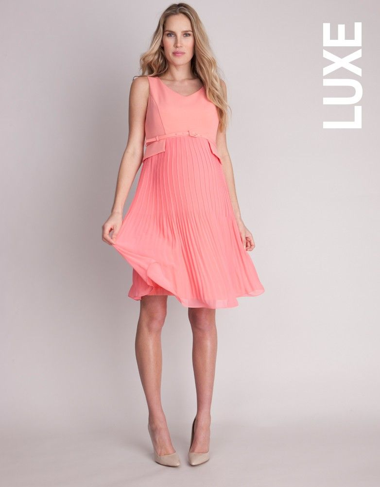 e51c658550 Seraphine s signature pleated maternity dress is a smart style in a fresh  coral ...