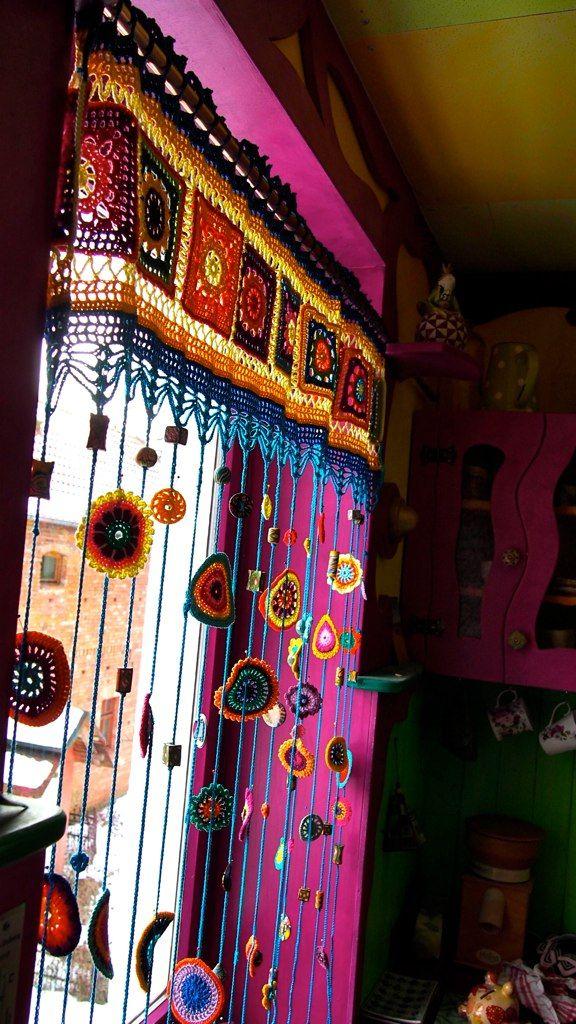 Love the crocheted rainbow hippie curtains!