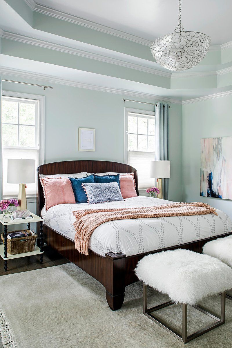 This BeforeandAfter Townhouse Makeover Proves the Power of Paint master suite with soft blue walls and tray ceiling