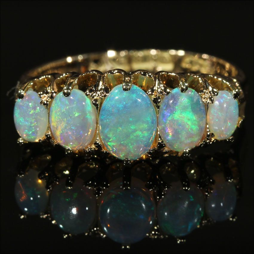 SUPERBE 5-Stone White fire opal ring