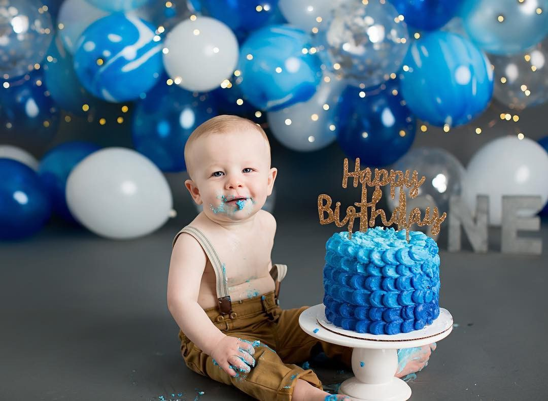 Baby Boy Cake Smash Session With Blue And White Balloons And A