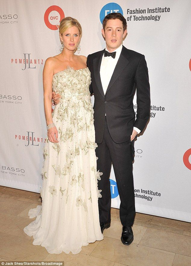 Good looking pair:The pregnant star showed off her bump in the beautiful strapless number...