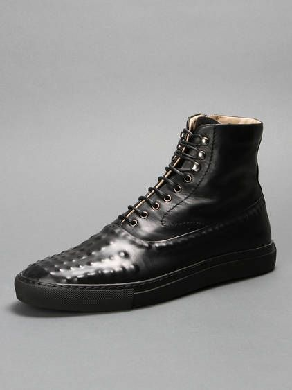Alexander McQueen high top leather boots with a side zip