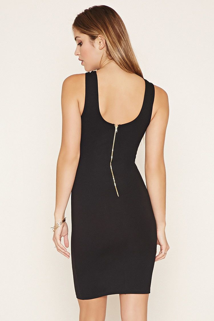 A knit mini dress with a sleeveless cut a strappy crisscross front