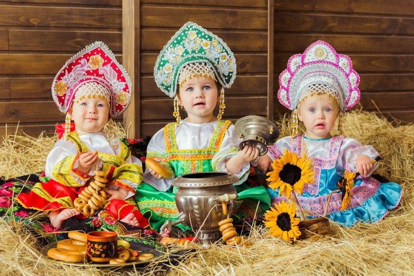 Three Russian babies in folk dress.  Well, that is too cute!