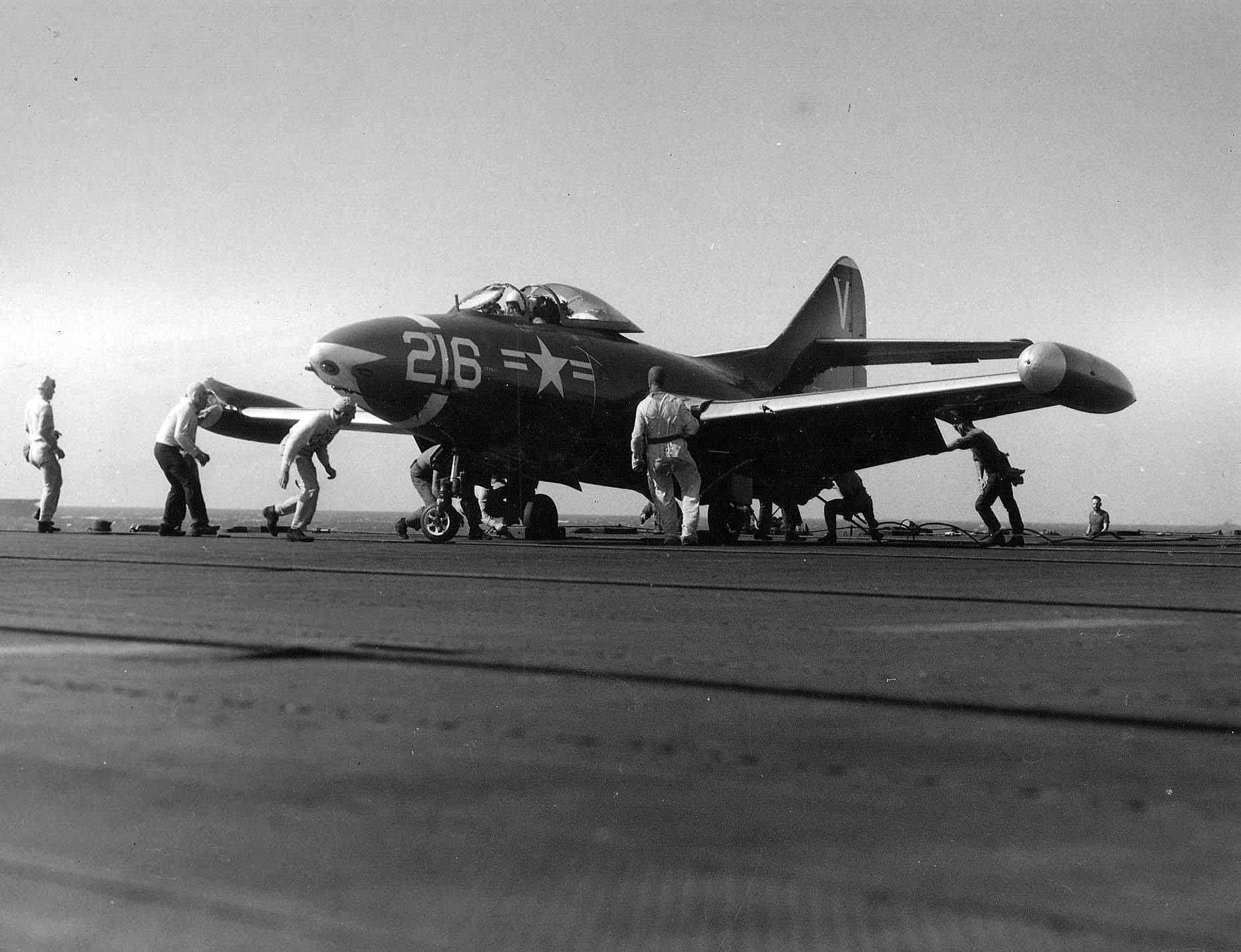 A battledamaged F9F2 Panther of Fighter Squadron (VF