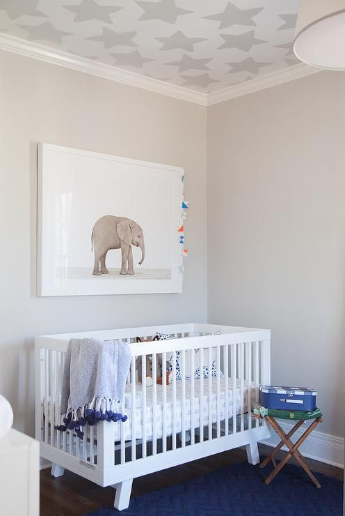 White And Gray Boy S Nursery Features A