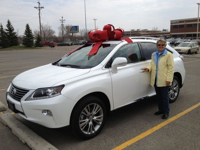 "A birthday gift was delivered directly to a customer who was trying to surprise his wife by Jon S. Jon drove to Fargo, North Dakota to personally deliver the surprise! When Carl + Ellen walked over, she saw Jon putting the ribbon on the car and said to her husband, ""I wonder who that lucky person is?"" and Carl yelled ""Happy Birthday!"" Ellen was thrilled!"