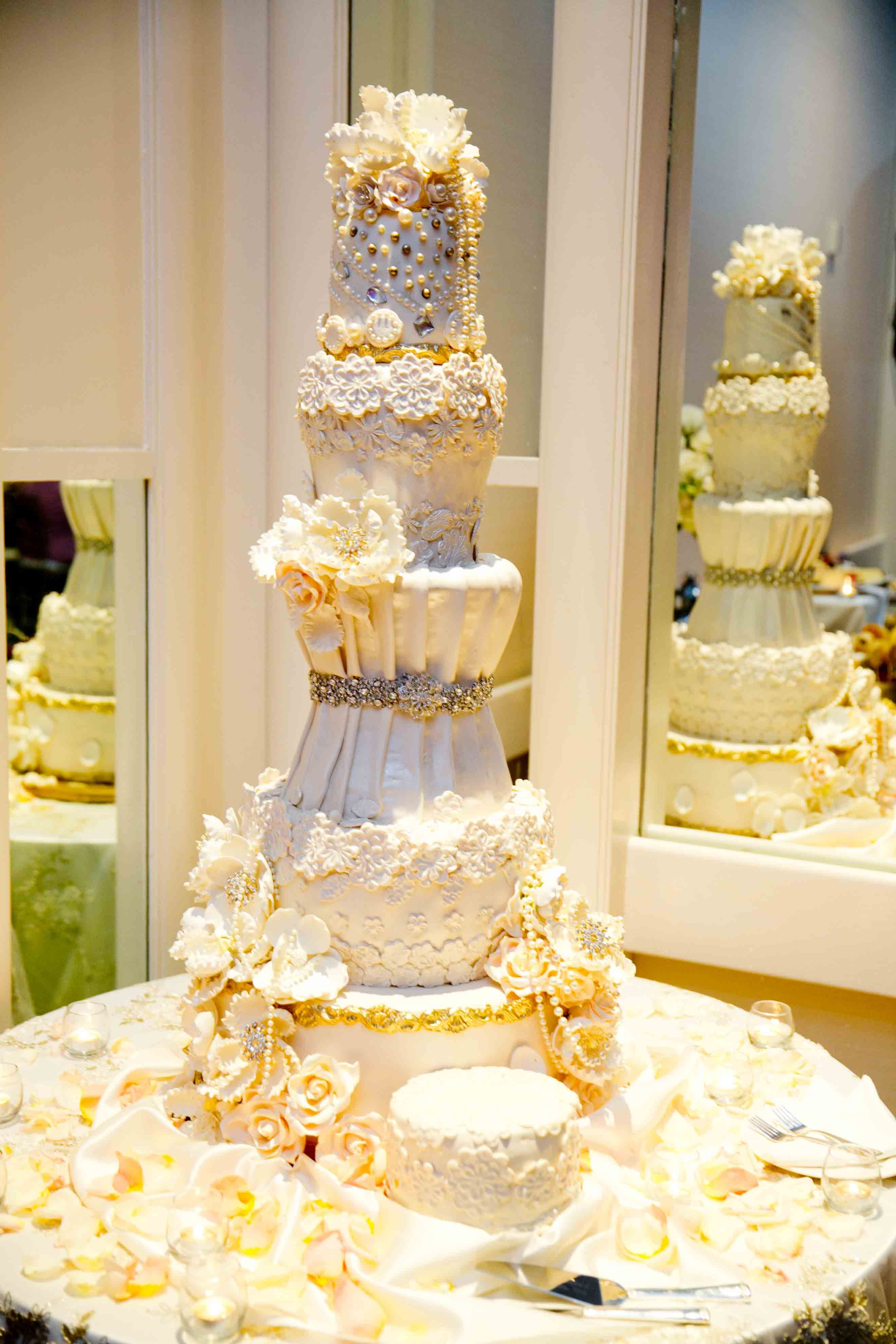 Off white 5 tier wedding cake with lots of detail and embellishments ...
