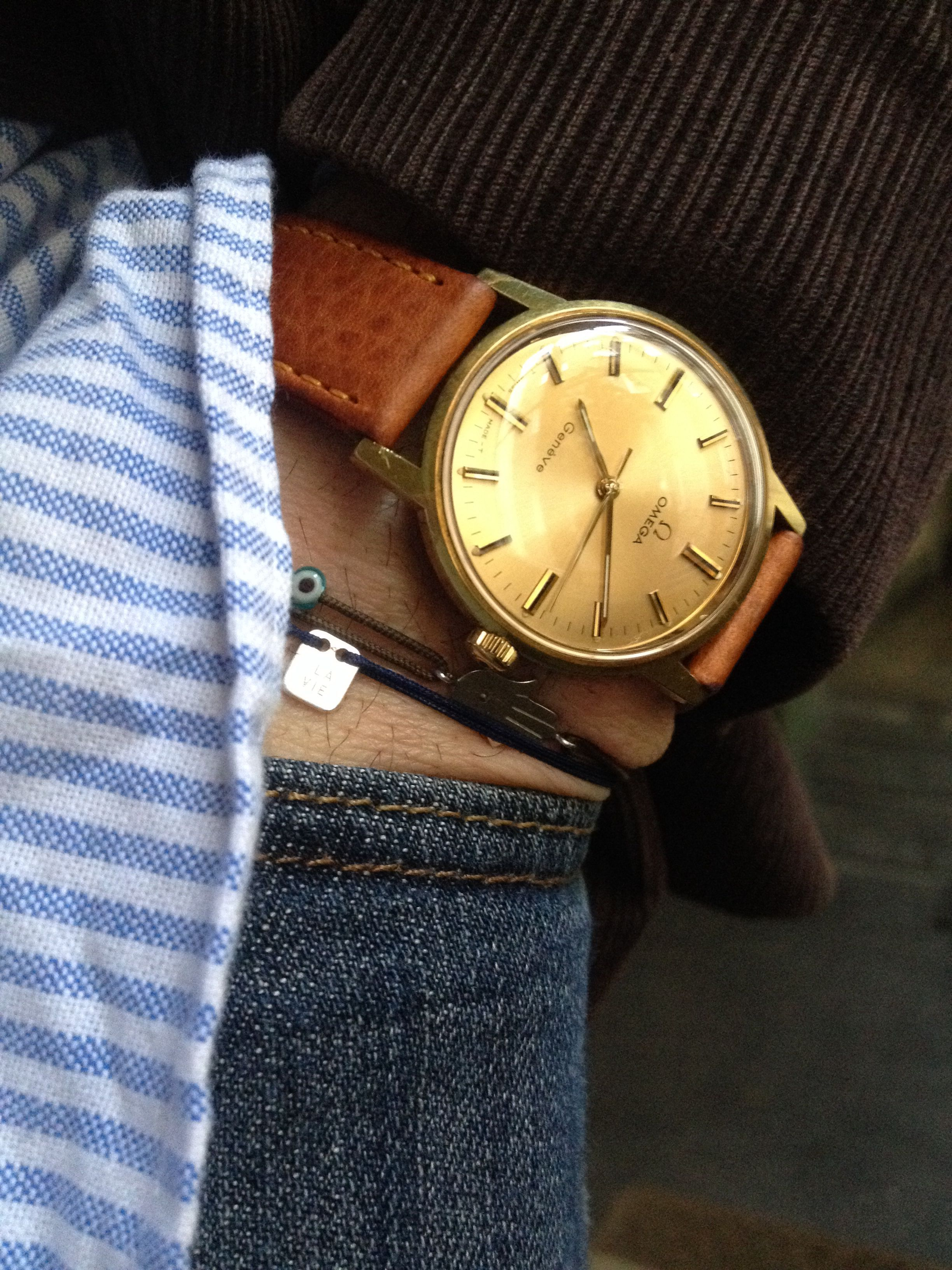 1960 Omega watch with gold face and tan leather strap