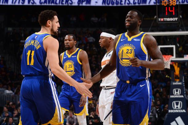 11f881c7815e Klay Thompson hifives Draymond Green of the Golden State Warriors on  January 15 2019 at the Pepsi Center in Denver Colorado NOTE TO USER User.