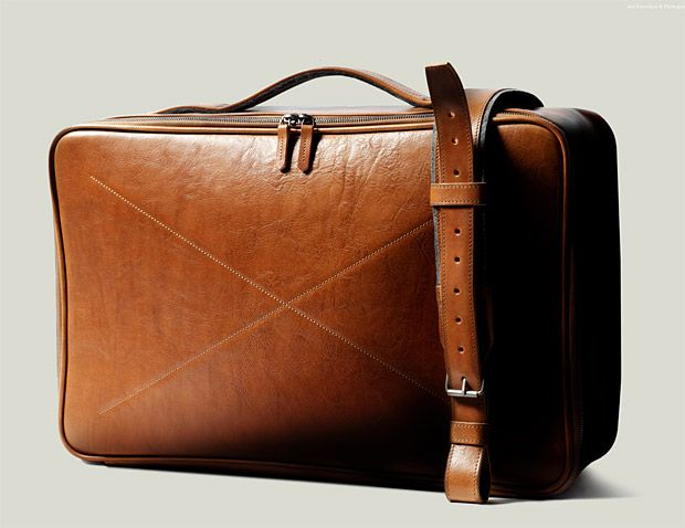 Hard Graft CarryOn Suitcase If you're a fan of classic materials like vegetable-tanned leather and 100% wool felt, this Italian-made carry on from Hard Graft might cause a lump in your lederhosen. It is completely handcrafted and features an adjustable shoulder strap with a felt-lined interior