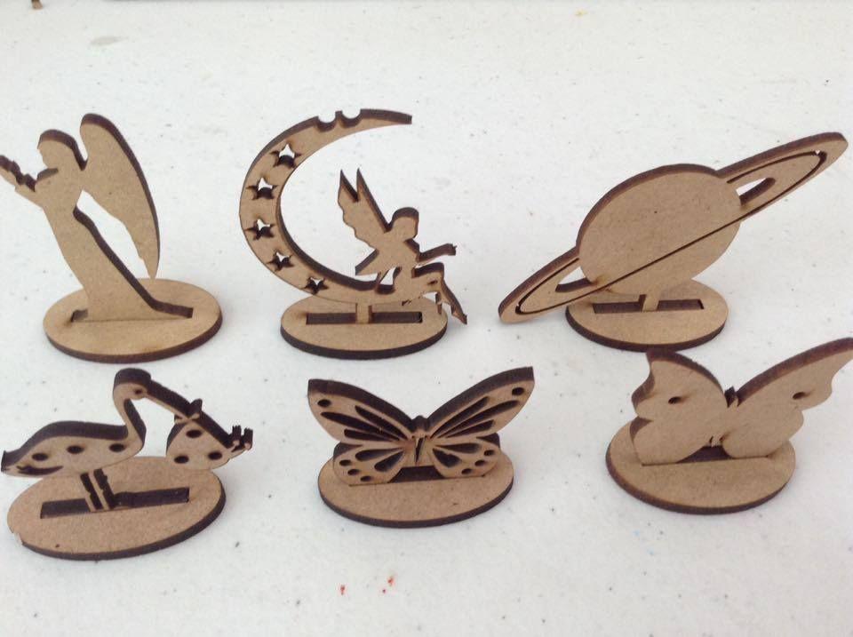 Porta aretes de angel, hada, planeta, cigüeña y mariposa.