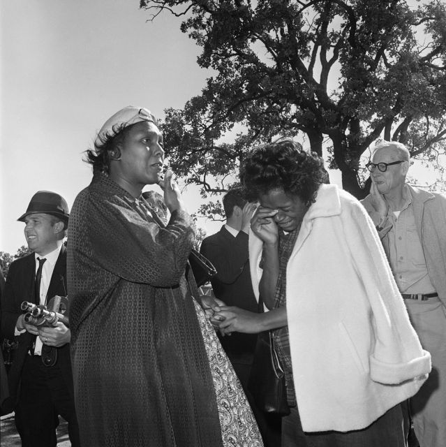 JFK: Two unidentified women burst into tears outside Parkland Hospital on hearing that President John F. Kennedy died from the bullet fired by an assassin while riding in a motorcade in Dallas. (Nov. 22, 1963)