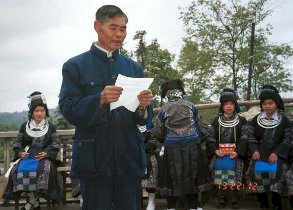 The village Secretary reading out a welcome and thanks to the Black Miao girls for dancing for us -  - Dai Lo village, Shi Zi township, Ping Ba county, Guizhou county 0010z19.jpg