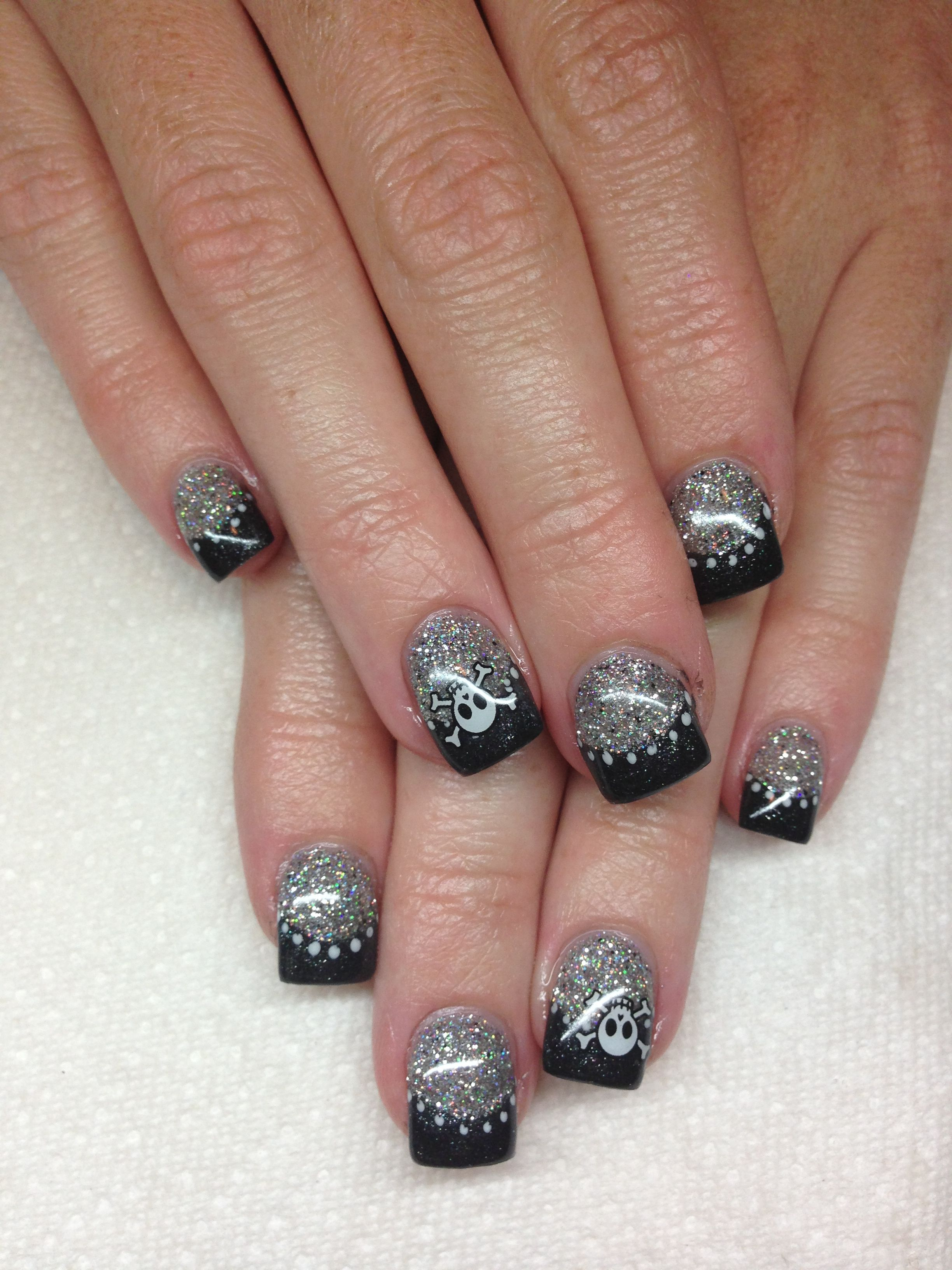 Gel nails. Silver glitter with black tips. Skull design ...