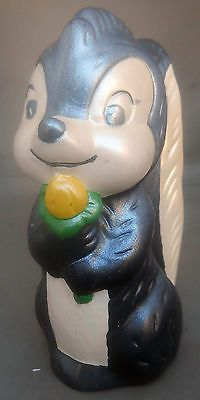 "Skunk Holding Yellow Flower Ceramic Dark Silver White Hollow 5¼"" Tall Unlabeled 