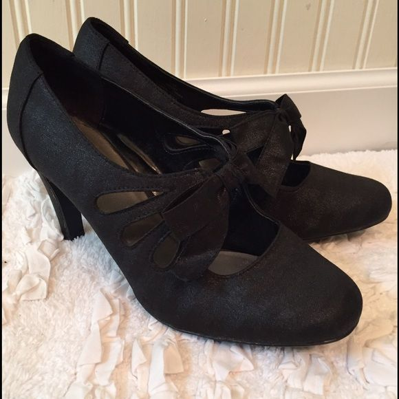 """Black Taffeta Mary Janes Style with Bow Beautiful black taffeta Naturalizer fabric shoes with tear drop cut outs on the sides and a bow on top. These are really stunning. Great for cocktail party or other special occasion. 4"""" heels. Naturalizer Shoes Heels"""