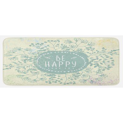 Photo of East Urban Home Ambesonne Be happy kitchen mat, doodle style wreath of wild flowers with positive thinking words and paint stains, plush decorative ki