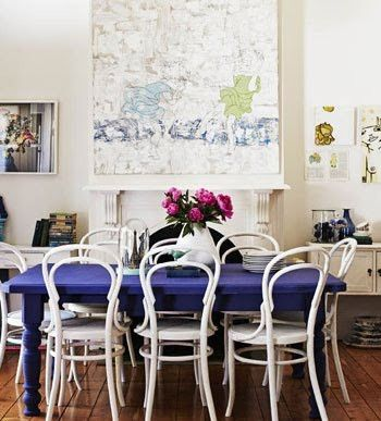 cobalt blue dining table, and white bentwood chairs.beatriz