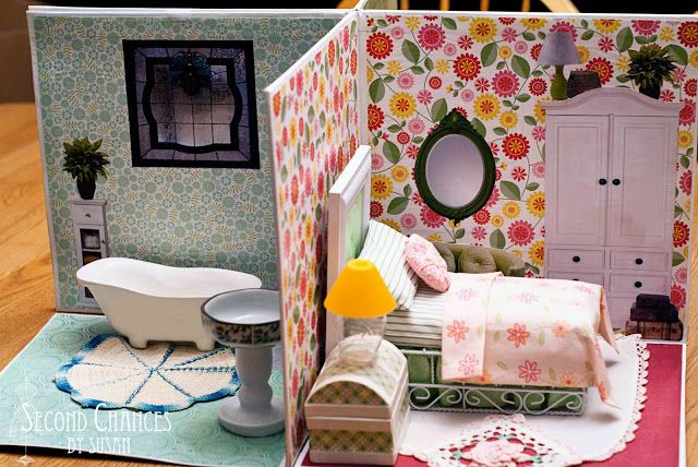 DIY Collapsible Dollhouse: Make an adorable Dollhouse with recycled items, Awesome idea and tutorial from Second Chances by Susan.