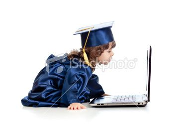funny child in academician clothes using laptop