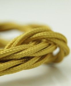 Rich gold Italian fabric cable brings an air of elegance to the rooms decor