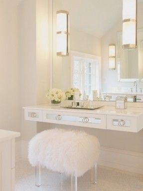 Beautiful Bathroom With White Mirrored Floating Vanity Accented With White  Sheepskin Vanity Stool With Lucite Base Paired With Polished Nickel Sconces  On ...
