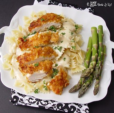 Corn flake chicken and Bowie pasta with Italian Cream Sauce:  3 large chicken breasts, 5 cups corn flakes, 3/4 cup flour, 1/2 teaspoon salt, 1/2 cup milk, 6 tablespoons olive oil, 12 ounce package bowtie/farfalle noodles,10 ounce container italian cheese and herb philadelphia cooking cream, 2 cans cream of chicken soup, 1 cup chicken broth, 1/2 cup milk, and fresh chopped parsley for garnish.