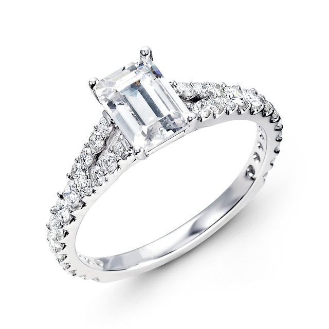 14kt white gold, classic diamond engagement ring. There are about 34 round brilliant cut diamonds set in the ring. The diamonds are about 0.57 ct tw, VS1-2 in clarity and G-H in color. Center stone is sold separately and in different sizes. Picured is a 7x5mm size diamond.