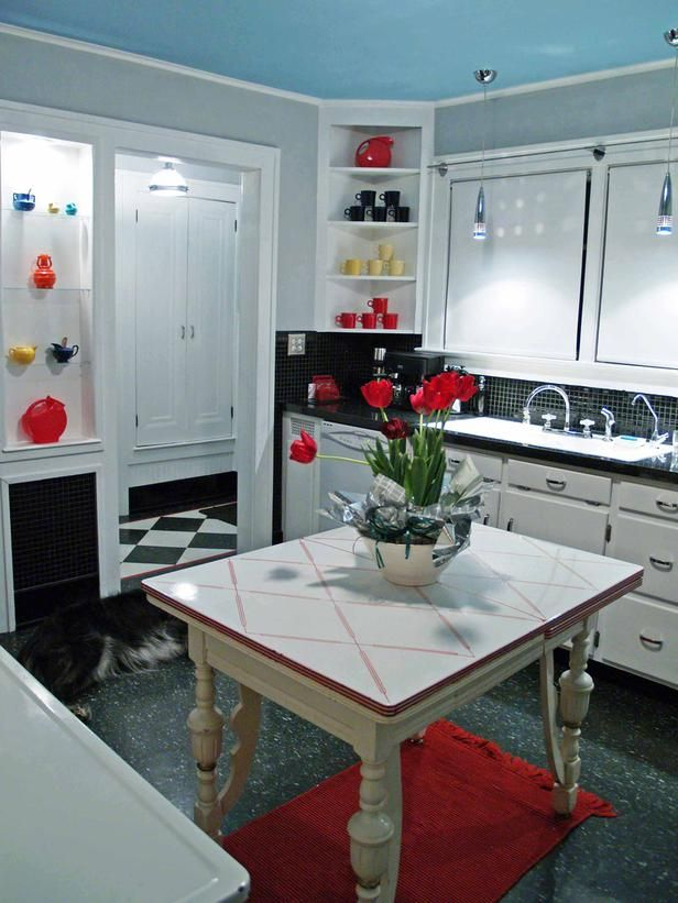 Colorful Kitchen Supplies: A Black-and-white Kitchen Acts As The Perfect Backdrop For