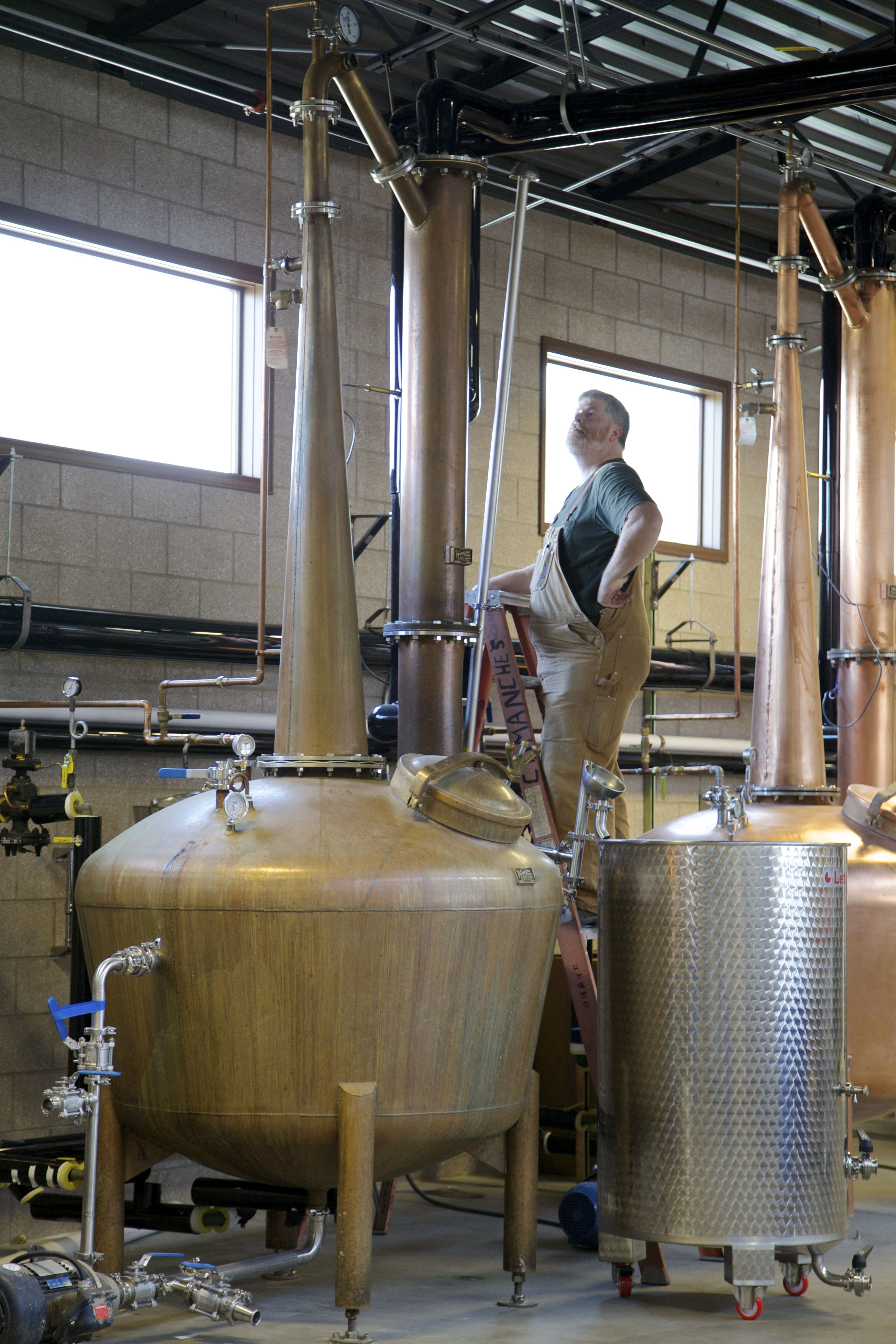 Owner And Distiller Todd Leopold Checks On One Of His Pot Stills
