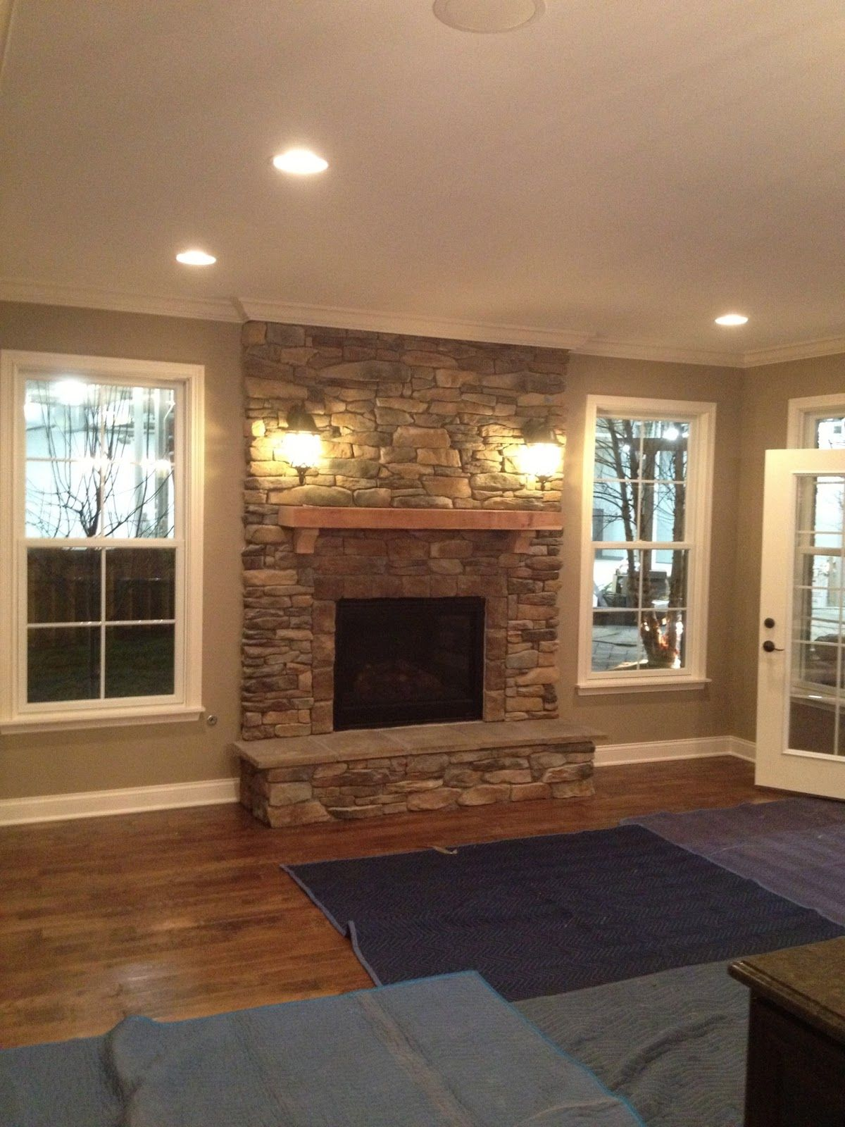 Stone fire place windows on each side and put window for Fireplace with windows on each side