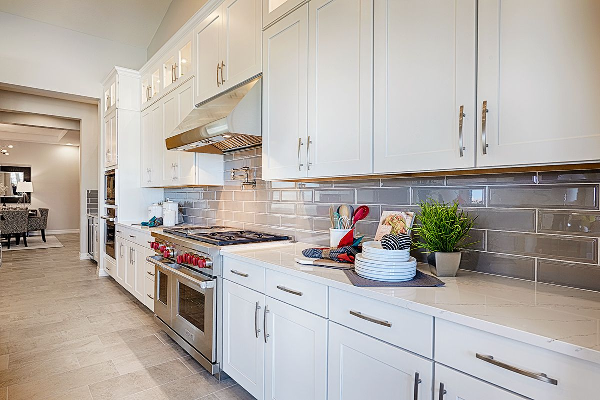 Abundant Counter Space White Cabinetry And Gray Subway Tile Backsplash Ryder Model Home Kitchen Litchfie Home Kitchens Kitchen Inspirations Kitchen Design
