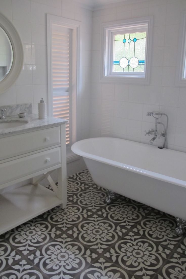 Why you should add a tile or mosaic feature to your interiors super pretty white bathroom with amazing patterned tiles dailygadgetfo Image collections