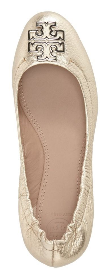 0073cc030 This darling gold Tory Burch ballet flat is sure to make a sparkling  statement.