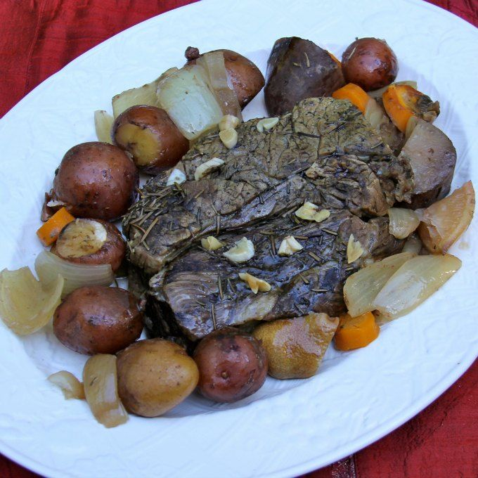 This pot roast recipe is slow cooked with classic carrots and potatoes with flavors of lemon and rosemary. @beeffordinner #SundaySupper