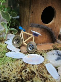 Tooth picks or match sticks, buttons and glue can make that perfect garden fairy bike. Fairies play, too. They don't always have to be flying around.